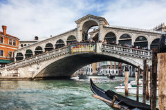 Rialto Bridge. Venice,Italy- February 18, 2012: Image of The Rialto Bridge,the oldest bridge accross the Grand Canal in Venice, full of people admiring a Royalty Free Stock Photography