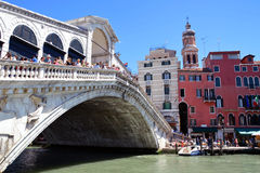 Rialto Bridge on Canal Grande in Venice. Photo shows the Rialto Bridge on the Canal Grande in Venice through which daily passes to the thousands of tourists on a Royalty Free Stock Images