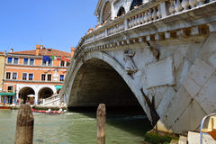 Rialto Bridge on Canal Grande in Venice. Photo shows the Rialto Bridge on the Canal Grande in Venice through which daily passes to the thousands of tourists on a Stock Photos