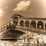 Rialto bridge on a clear day in sepia tone Royalty Free Stock Image