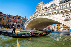 Rialto Bridge and gondola in Venice Royalty Free Stock Image