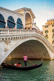 Rialto Bridge with gondola in Venice, Italy Royalty Free Stock Photos