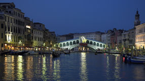 Rialto Bridge - Grand Canal - Venice - Italy. The Rialto Bridge and the Grand Canal at dusk in the city of Venice in Italy Royalty Free Stock Photography