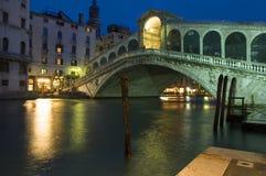 Rialto Bridge at night. Gondolas parked on the Grand Canal in Venice,Italy Royalty Free Stock Photos