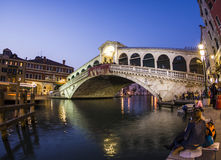 Rialto bridge by night with people Stock Photo