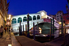 Rialto bridge by night in Venice Stock Photo