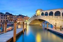 Rialto bridge at night in Venice stock images