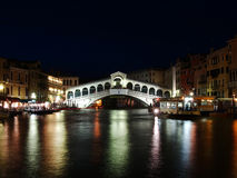 Rialto Bridge in Venice, Italy. VENICE, ITALY - JULY 02: Tourist enjoy day and night on the Rialto Bridge on July 02, 2011 in Venice, Italy. Originally built out Stock Images