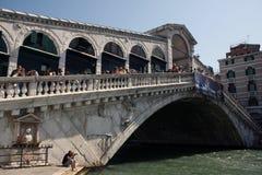 Rialto bridge in venice Italy with tourists Stock Image