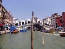 Rialto Bridge Venice Italy. View with boats and Rialto Bridge over the Grand Canal in  Venice Italy Stock Photography