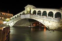 The Rialto Bridge in Venice at night Stock Photos