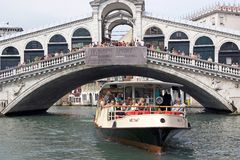 Rialto bridge and water bus Royalty Free Stock Image