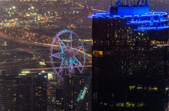 Rialto Tower and Melbourne Star observation wheel in Melbourne, Australia. The illuminated tip of the Rialto building and the Melbourne Star observation wheel in Stock Photo