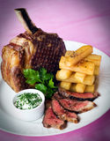 Rib of beef and chunky chips Stock Photos