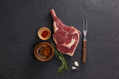 Rib chop and ingredients. Against black background royalty free stock images