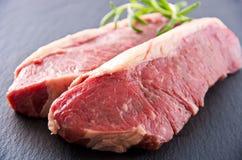 Rib Eye beef steaks on a slate Royalty Free Stock Photos
