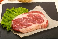 Rib eye raw steak. Ready for cooking royalty free stock image