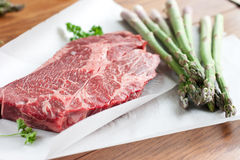 Rib-eye steak and asparagus Royalty Free Stock Image