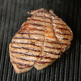 Rib-Eye Steak Cooking on Griddle Royalty Free Stock Photos