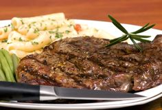 Rib Eye steak dinner 2 stock photo