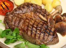 Rib-eye Steak Dinner. With shiitake mushrooms and new potatoes Stock Photo