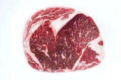 Rib-eye steak fresh raw beef steak isolated on white background. Fresh raw beef steak isolated on white background, top view Stock Photos
