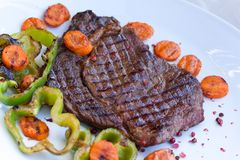 Rib Eye Steak with green bell peper Stock Images