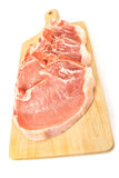 Rib eye steak pork meat on cutting board isolated Stock Photography
