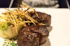 Rib eye steak in a restaurant of El Calafate, Argentina. Rib eye steak served in a restaurant of El Calafate, Argentina royalty free stock images