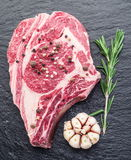 Rib eye steak with spices. Royalty Free Stock Images
