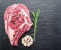 Rib eye steak with spices. Royalty Free Stock Photos
