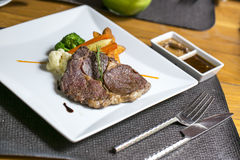 Rib-eye Steak on the table Stock Photos