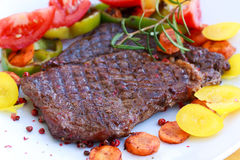 Rib Eye Steak with tomato,yellow bell peper Royalty Free Stock Images