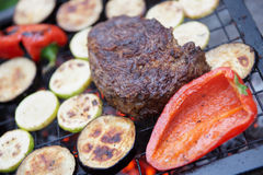 Rib eye steak with vegetables. On bbq grill Royalty Free Stock Image