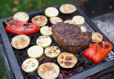 Rib eye steak with vegetables. On bbq grill Stock Photo