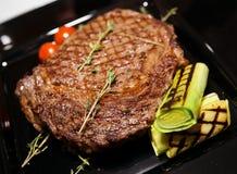 Rib eye steak with vegetables Stock Photos