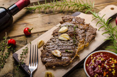 Rib eye steak with wine Stock Images