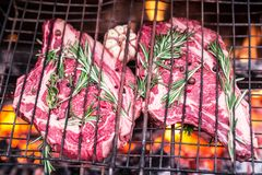 Rib eye steaks and grill. Rib eye steaks and grill with burning fire behind them Royalty Free Stock Photos