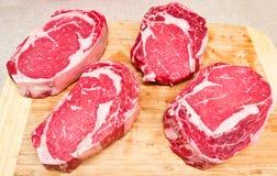 Rib Eye steaks. On wood board Royalty Free Stock Photos