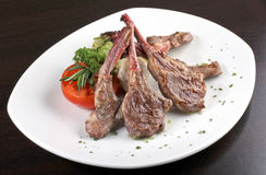Rib of lamb & vegetables. Rib of lamb grill with vegetables Royalty Free Stock Images