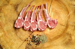 Rib roasts on cutting board. Raw Rip roasts on cutting board Royalty Free Stock Photo