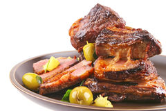 Rib S And Green Olives On Dish Side View Stock Image