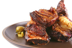 Rib's and green olives on dish Royalty Free Stock Photography