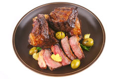 Rib's and olive on dish Stock Photography