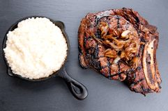 Rib steak with creamy risotto Royalty Free Stock Photography