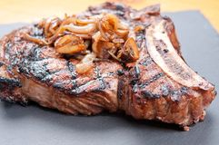 Rib steak with creamy risotto Royalty Free Stock Image