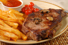 Rib steak and fries Stock Photos