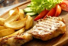 Rib steak fries and vegetables