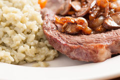 Rib steak grilled to perfection with creamy risotto Stock Image