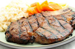 Rib steak with risotto Royalty Free Stock Photos